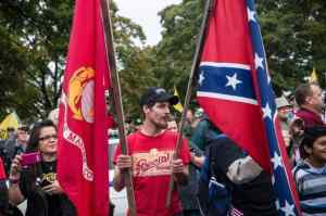 Tea Party Idiot waves Confederate Flag at UNITED STATES VETERANS Protest