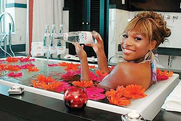 Beyonce looking girl bathes in Evian